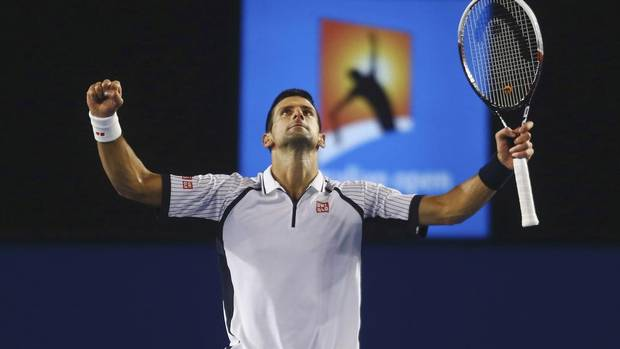 Novak Djokovic of Serbia celebrates defeating Tomas Berdych of Czech Republic in their men's singles quarter-final match at the Australian Open tennis tournament in Melbourne January 22, 2013. (POOL/REUTERS)