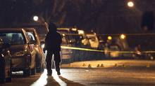 A police officer investigates at a residential neighbourhood in southeast Vancouver after a woman was shot to death in a vehicle. Ben Nelms for The Globe and Mail (Ben Nelms for The Globe and Mail/Ben Nelms for The Globe and Mail)