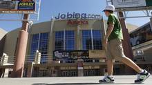A lone pedestrian walks past Jobing.com Arena, Wednesday, June 13, 2012, in Glendale, Ariz., where the Phoenix Coyotes NHL hockey team plays home games. (Ross D. Franklin/AP)