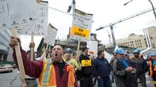 Construction workers strike in Montreal June 17, 2013. Negotiations broke down Saturday. (Paul Chiasson/THE CANADIAN PRESS)