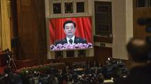 Chinese President Hu Jintao is projected on a large screen while giving an address at the opening session of the 18th Communist Party Congress. (SIM CHI YIN/NYT)