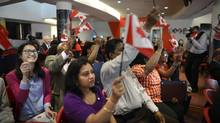 Canadian flags are proudly waved during a citizenship ceremony. (Fred Lum/The Globe and Mail)