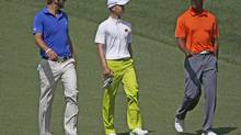 Asia-Pacific Amateur Championship winner Guan Tianlang of China walks with Dustin Johnson and Tiger Woods during the 2013 Masters golf tournament (MIKE SEGAR/REUTERS)