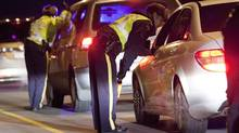 RCMP officers preform a ride program to get drivers who have been drinking and driving off the rode in Coquitlam, British Columbia on December 7, 2013. (Ben Nelms For The Globe and Mail)