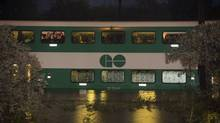 Stranded passengers await rescue on a flooded GO train in Toronto on Monday, July 8, 2013. (FRANK GUNN/THE CANADIAN PRESS)