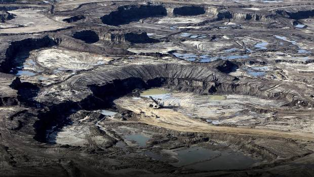 The Syncrude Canada Ltd. mine stands at the Athabasca oil sands in this aerial photograph taken near Fort McMurray, Alberta, Canada, on Thursday, June 4, 2015.