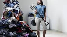 In two-income households, domestic chores are an ongoing source of marital stress. (Ryan McVay/Getty Images)