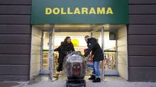 Customers shop at the Dollarama discount store location at Spadina Ave and Adelaide St. West in Toronto, Ont. Dec. 7/2011. (Kevin Van Paassen/Kevin Van Paassen/The Globe and Mail)