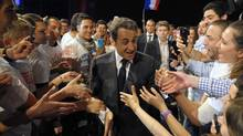 France's President and UMP party candidate for the 2012 French presidential elections Nicolas Sarkozy arrives at a campaign rally in Nice, southern France April 20, 2012. France goes to the polls on Sunday in the first round of its presidential election. (Philippe Wojazer/Reuters)