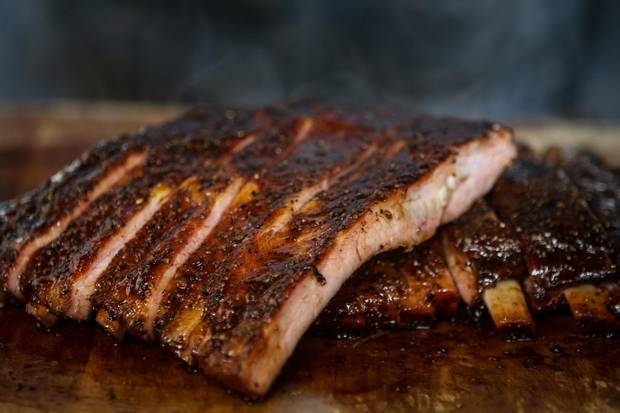 Adamson Barbecue uses sugar maple, oak and cherry wood to barbecue their brisket, spareribs, turkey breast and sausage inside their 600 pound Oyler wood-burning smoker.
