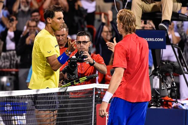 Rafael Nadal of Spain congratulates Denis Shapovalov of Canada for his victory during day seven of the Rogers Cup presented by National Bank at Uniprix Stadium on August 10, 2017 in Montreal, Quebec, Canada.