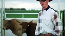 Bullrider Greg Whitlow is seen in this file photo. (Todd Korol/The Globe and Mail)