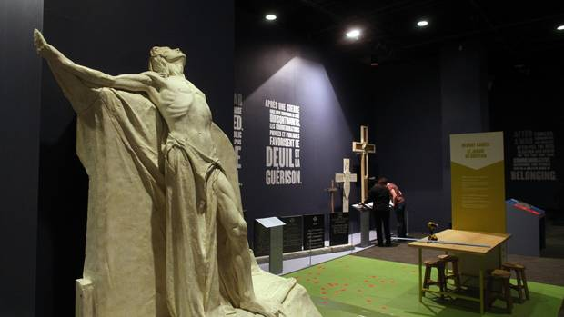 Workers put the final touches on the new display at the museum on Monday. The exhibit includes maquettes built by sculptor Walter Allward for the massive Vimy Ridge monument in France.