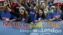 Demonstrators protest against job cuts in central London November 5, 2011. Many of the demonstrators had marched from Jarrow in north east England, recreating a 1936 protest march against unemployment. (Luke MacGregor/Reuters/Luke MacGregor/Reuters)