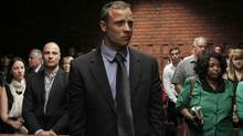 Oscar Pistorius awaits the start of court proceedings in the Pretoria Magistrates court, Feb. 19, 2013. (Siphiwe Sibeko/Reuters)
