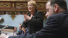Quebec Premier Pauline Marois responds to the Opposition during the question period at the Quebec legislature, Thursday February 21, 2013 as Quebec Minister of Higher Education, Pierre Duchesne, listens. (CLEMENT ALLARD/THE CANADIAN PRESS)