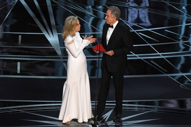 Actress Faye Dunaway and actor Warren Beatty arrive on stage to announce the winner.