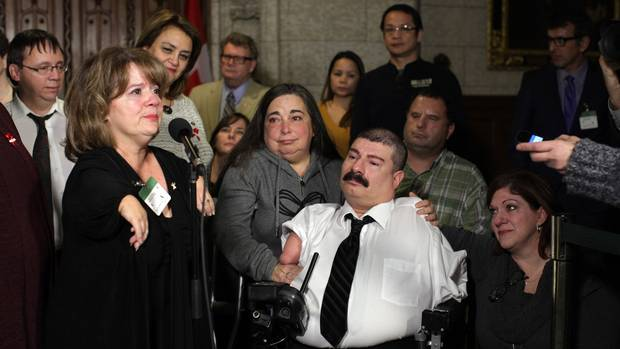 Thalidomide survivor Mercedes Benegbi speaks to the media on Dec. 1, 2014.
