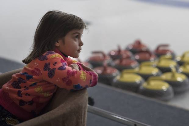 Haneen Khalifih, 6, (from Syria) looks out over the curling rinks while on a day trip to the Royal Canadian Curling Club.