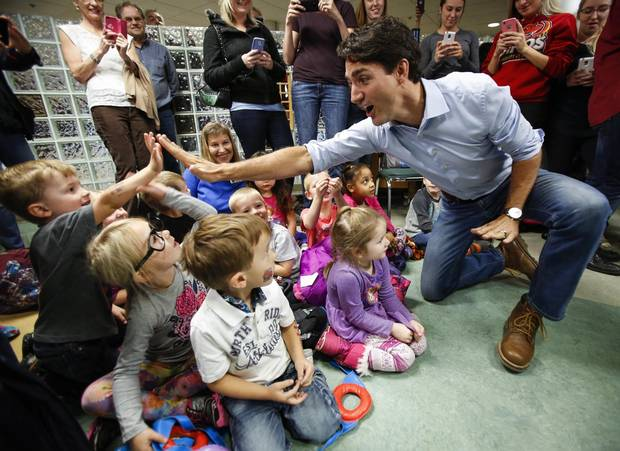 Prime Minister Justin Trudeau high fives pre-schoolers at Medicine Hat College on Oct. 14, 2016.