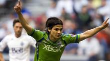 Seattle Sounders' Fredy Montero celebrates his goal against the Vancouver Whitecaps during the second half of their MLS soccer game in Vancouver, British Columbia May 19, 2012. REUTERS/Ben Nelms (Ben Nelms/Reuters)