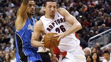 Toronto Raptors forward Hedo Turkoglu drives to the basket past Orlando Magic forward Matt Barnes, left, during the first half of their NBA basketball game in Toronto November 1, 2009. (MIKE CASSESE)