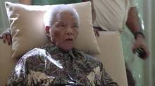 In this image taken from video, the ailing anti-apartheid icon Nelson Madela is filmed Monday April 29, 2013, more than three weeks after being released from hospital. Mandela was treated in hospital for a recurring lung infection. (AP)