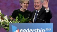 Jean Charest, former premier of Quebec, is shown with his wife, Michele Dionne, at the Quebec Liberal leadership convention in Montreal. Mr. Charest was celebrated by his party on March 16, 2013. (Ryan Remiorz/The Canadian Press)