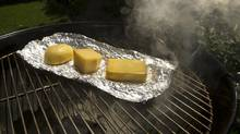 In the smoker: Mozzerella, Pecorino Romano, and Balderson 3 year Cheddar. (Kevin Van Paassen/Kevin Van Paassen/The Globe and Mail)