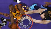 Los Angeles Lakers' Kobe Bryant goes up to shoot past Denver Nuggets' Timofey Mozgov of Russia during Game 7 of their NBA Western Conference basketball playoff series in Los Angeles, California May 12, 2012. (LUCY NICHOLSON/REUTERS)