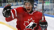 Canada's Ty Rattie celebrates his goal against Slovakia during the second period of their preliminary round game during the 2013 IIHF U20 World Junior Hockey Championship in Ufa Dec. 28, 2012. (MARK BLINCH/REUTERS)