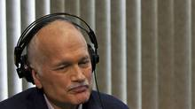 NDP Leader Jack Layton listens to a caller as he participates in a phone-in radio show during a campaign stop in Kitchener, Ont. on March 29, 2011. (Andrew Vaughan/THE CANADIAN PRESS)