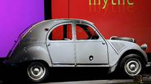 The Citroen 2CV's light weight allowed it to operate with some of the smallest engines ever fitted into a passenger car. The original 1948 model had only 9 horsepower, and the top speed was 64 km/h. Although engine power was gradually increased, it was only in 1981 that the 2CV finally became capable of hitting 115 km/hr - a speed that is considered the bare minimum for operating on North American highways. (FRANCOIS GUILLOT/FRANCOIS GUILLOT/AFP/Getty Images)