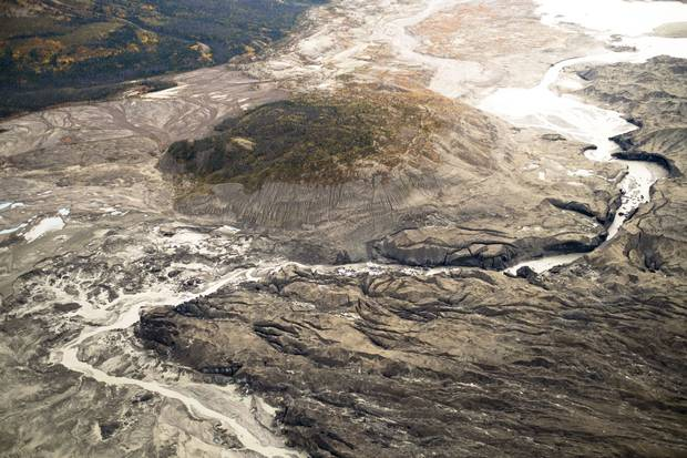 A stream flows through the toe of Kaskawulsh Glacier in Yukon's Kluane National Park. In 2016, this channel allowed the glacier's meltwater to drain in a different direction than normal, resulting in the Slims River's water being rerouted to a different river system.