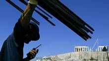 A construction worker directs work on the roof of the Acropolis Museum in Athens March 21, 2006. (JOHN KOLESIDIS/REUTERS/JOHN KOLESIDIS/REUTERS)