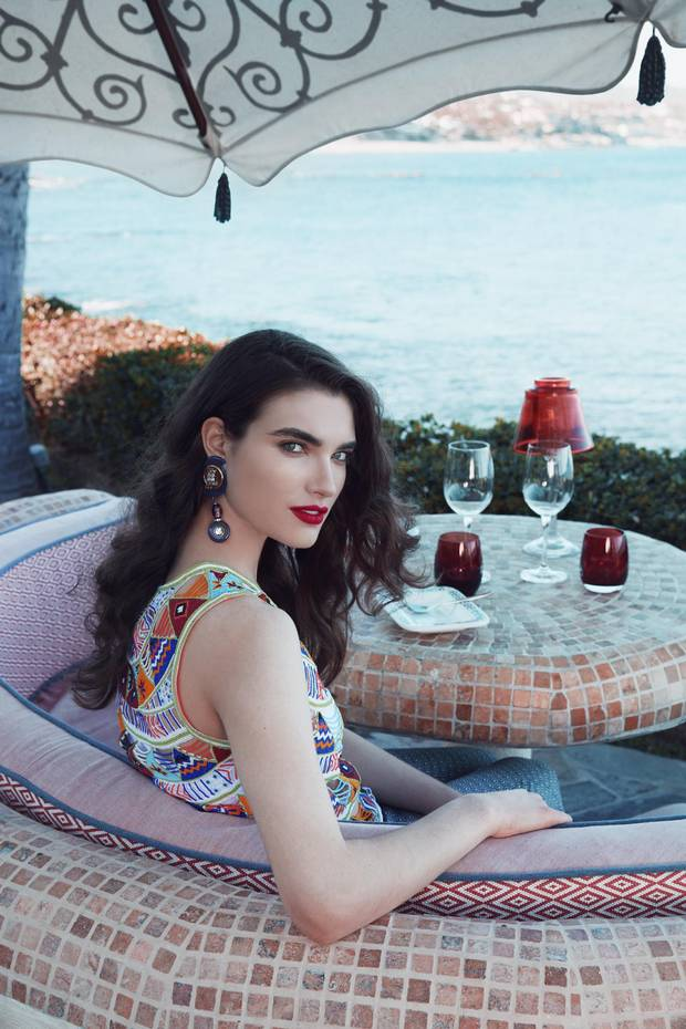 The casual restaurant, Agua, incorporates coveted half-round banquettes that look out over the ocean. At night, their tasseled umbrellas glow in the moonlight. Pia Pauro beaded top, $288 (U.S.), Paloma jumpsuit, $409 (U.S.) at Neo One & Only Palmilla. Vintage earrings, $300 through www.caroletanenbaum.com.