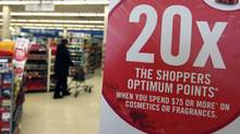 A sign advertises Shoppers Drug Marts's Optimum points loyalty program. (Deborah Baic/The Globe and Mail/Deborah Baic/The Globe and Mail)