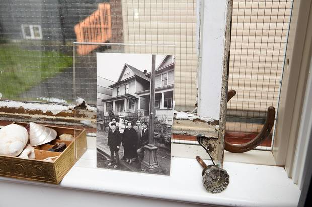 A photo of the China family in front of their home.