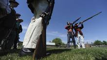 Len Heidebrecht (second from right) works with militia re-enactors during activities at Fort York on Victoria Day. (Fred Lum/The Globe and Mail)