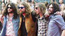 The Sheepdogs pose for photographs on the red carpet during the 2011 MuchMusic Video Awards in Toronto on Sunday, June 19, 2011. (Darren Calabrese/Darren Calabrese / CP)