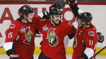 Ottawa Senators left wing Nick Folign, centre, congratulates Zack Smith, left, on his goal and Daniel Alfredsson on his assist. (Adrian Wyld/The Canadian Press/Adrian Wyld/The Canadian Press)