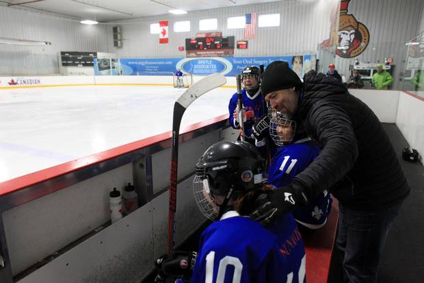 Nunavik Nordiks coach Joe Juneau talks to his players during a game March 24, 2017 in Ottawa. The Inuit girl's hockey team is in Ottawa for a tournament. DAVE CHAN / THE GLOBE AND MAIL