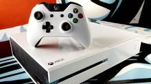 """Xbox One Special Edition """"Sunset Overdrive"""" Bundle, featuring a sleek white console and wireless controller, a digital copy of the game, and special Day One edition in-game items. (Microsoft)"""