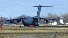 A Canadian Forces C-17 cargo plane taxis for takeoff at CFB Trenton Jan. 16, 2013. = (J.P. MOCZULSKI/The Globe and Mail)