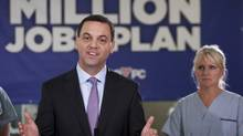 Ontario Progressive Conservative Party Leader Tim Hudak, left, speaks to the media with registered nurse Kathy Kordos during a campaign stop at the Niagara Health System hospital in St. Catharines, Ont., on May 31. (Aaron Lynett/THE CANADIAN PRESS)