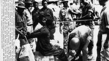 An Igbo captive is captured and threatened by Nigerian federal soldiers in 1968. (AP)