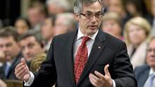 Treasury Board President Tony Clement speaks during Question Period in the House of Commons on June 13, 2011. (Adrian Wyld/THE CANADIAN PRESS)