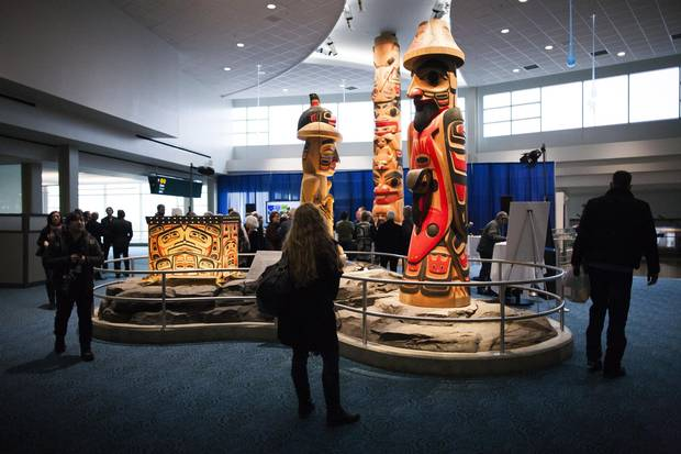 Cedar carvings by Reg Davidson, an acclaimed Haida artist, are displayed in the Link atrium area of Vancouver International Airport.