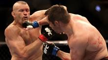 Rich Franklin, right, of Cincinnati, Ohio, hits Chuck Liddell, of Santa Barbara, Calif., during UFC 115 in Vancouver, British Columbia, Canada, on Saturday June 12, 2010. (Darryl Dyck)