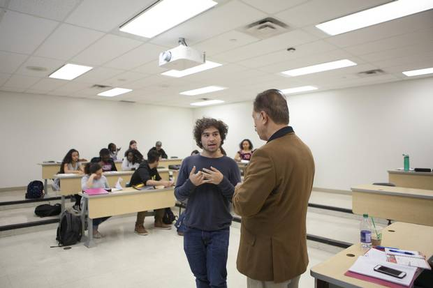 Kyle Echakowitz, who is on the autism spectrum, speaks to his instructor during class at Seneca College.